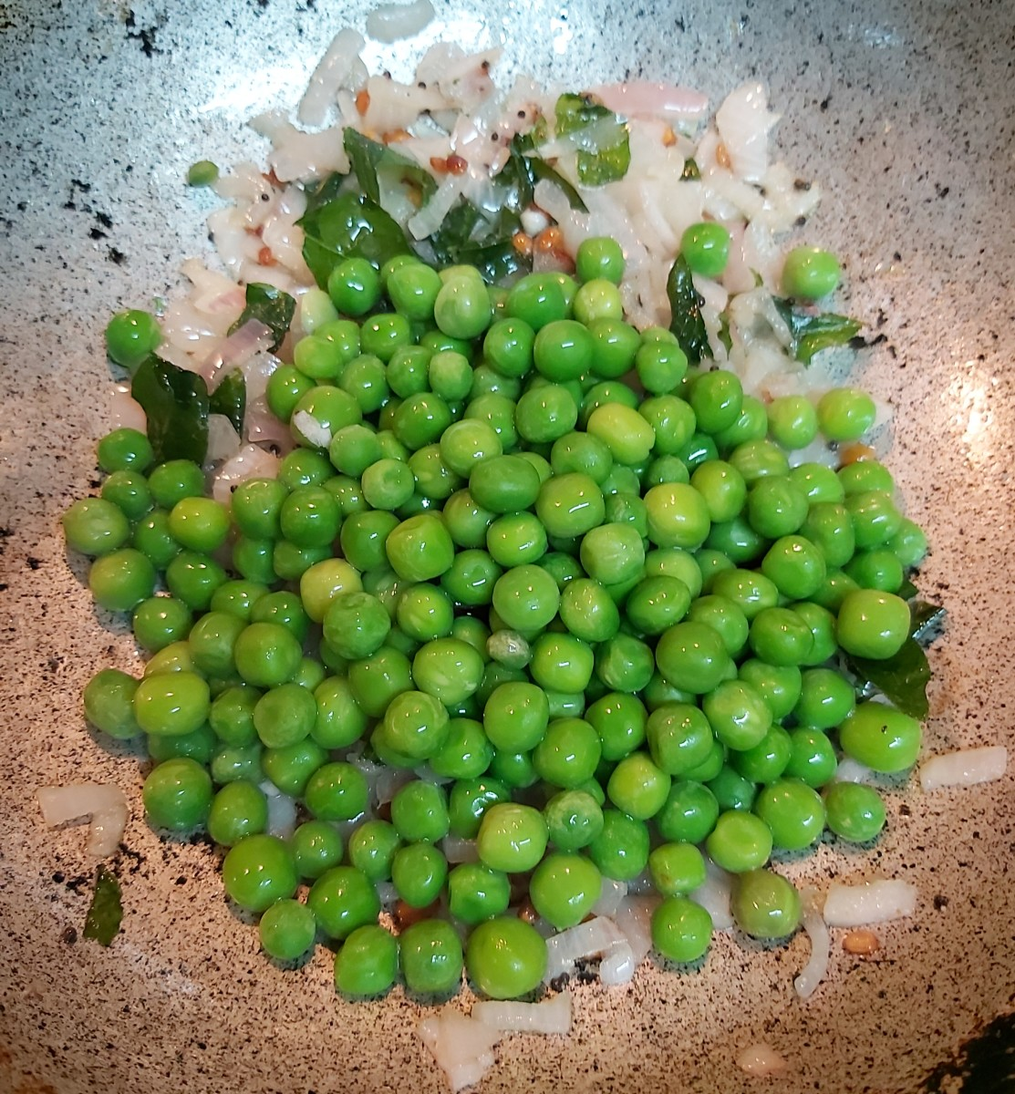 Add 1/2 cup of frozen peas (if using).