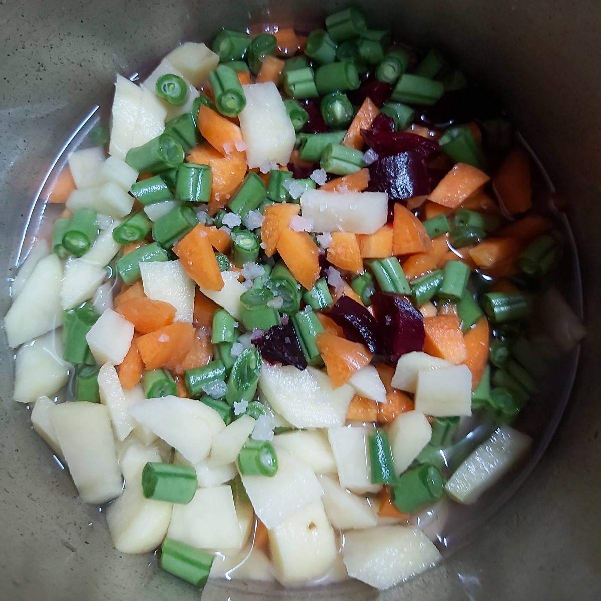 Add 1/2 cup of water and salt to taste (add just enough water to immerse the vegetables, not too much).