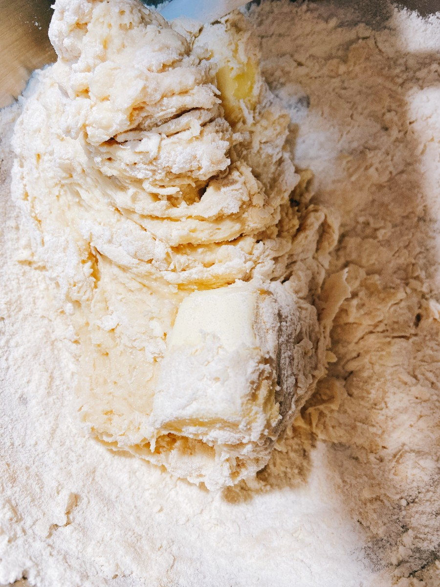 Combine the flour and butter into the yeast mixture.