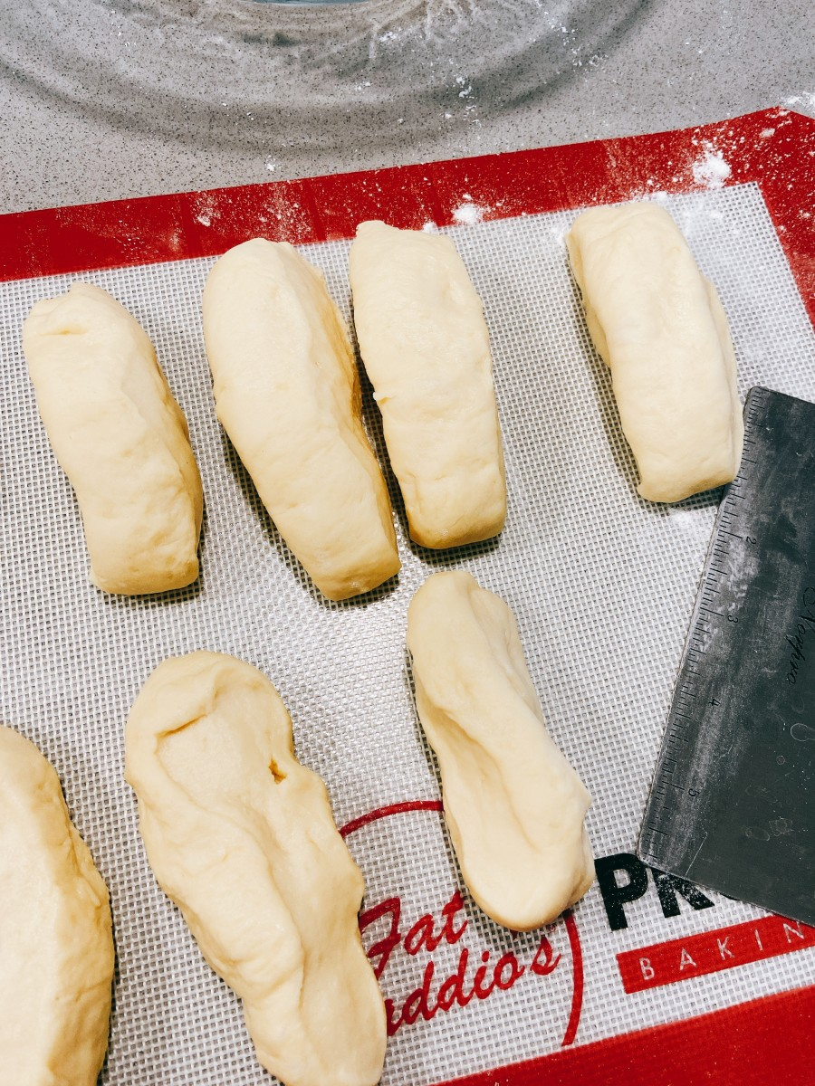 Divide the dough into 12 equal-sized portions.