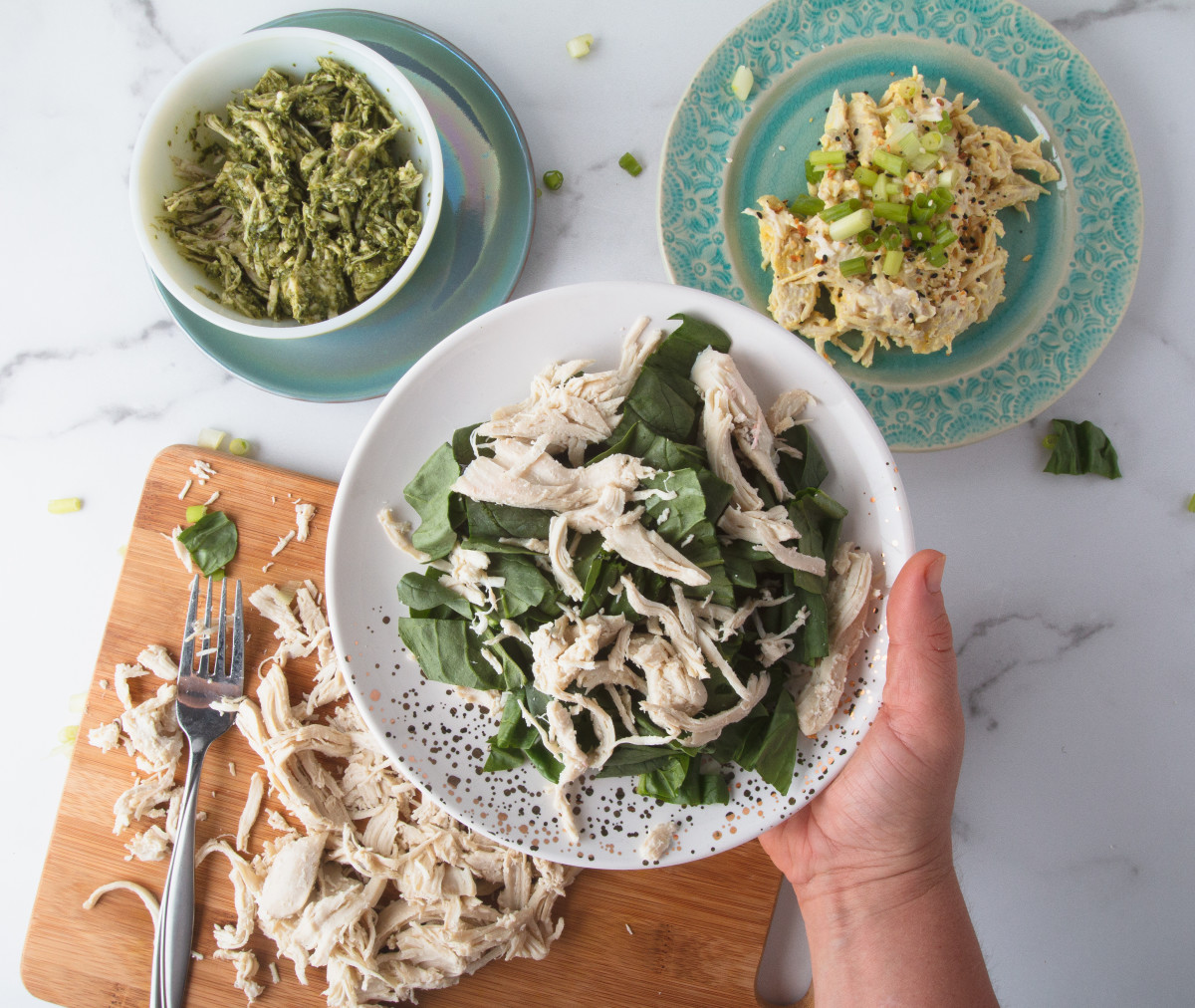 Shredded chicken can be used on top of greens for a simple salad.