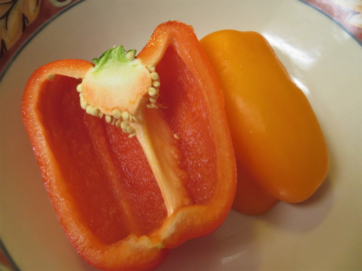 Half of a red and orange bell pepper ready to be chopped