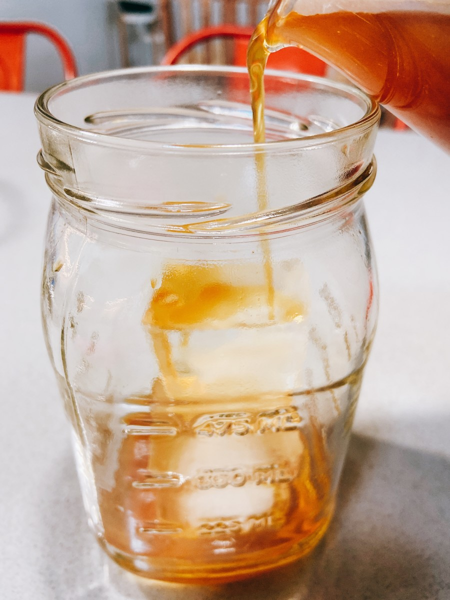 In a glass, add a few ice cubes and pour the cold brew coffee.