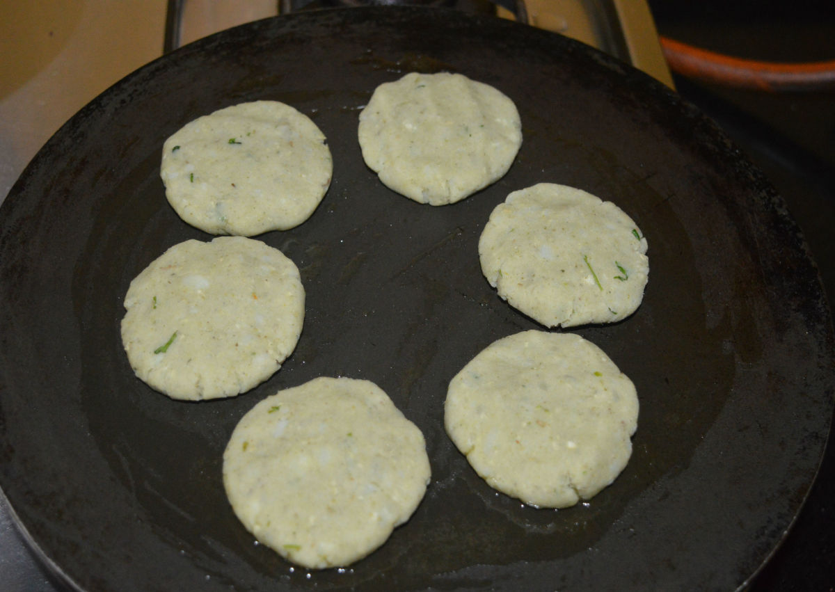 Heat a griddle or pan and grease it with some oil. Place the patties on it one near the other.