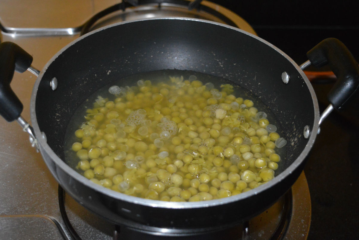 Step two: Cook soaked white peas with some water and salt. Add it to a deep-bottomed pan.