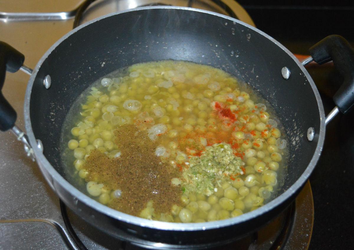 Heat the pan. Add ginger-green chili paste, garam masala powder, red chili powder, and remaining salt.