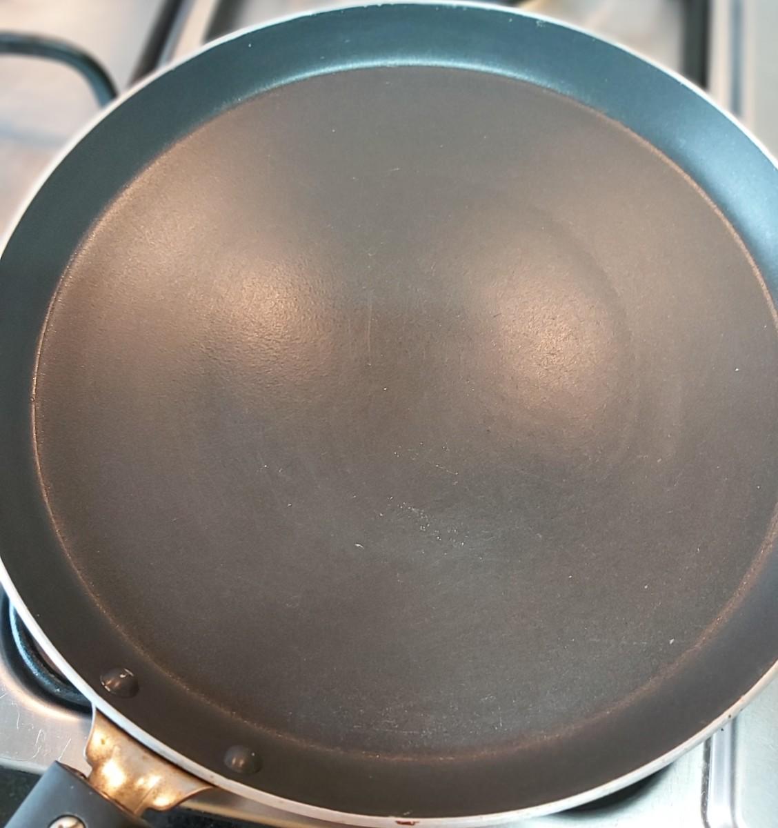 Heat a pan over medium heat.