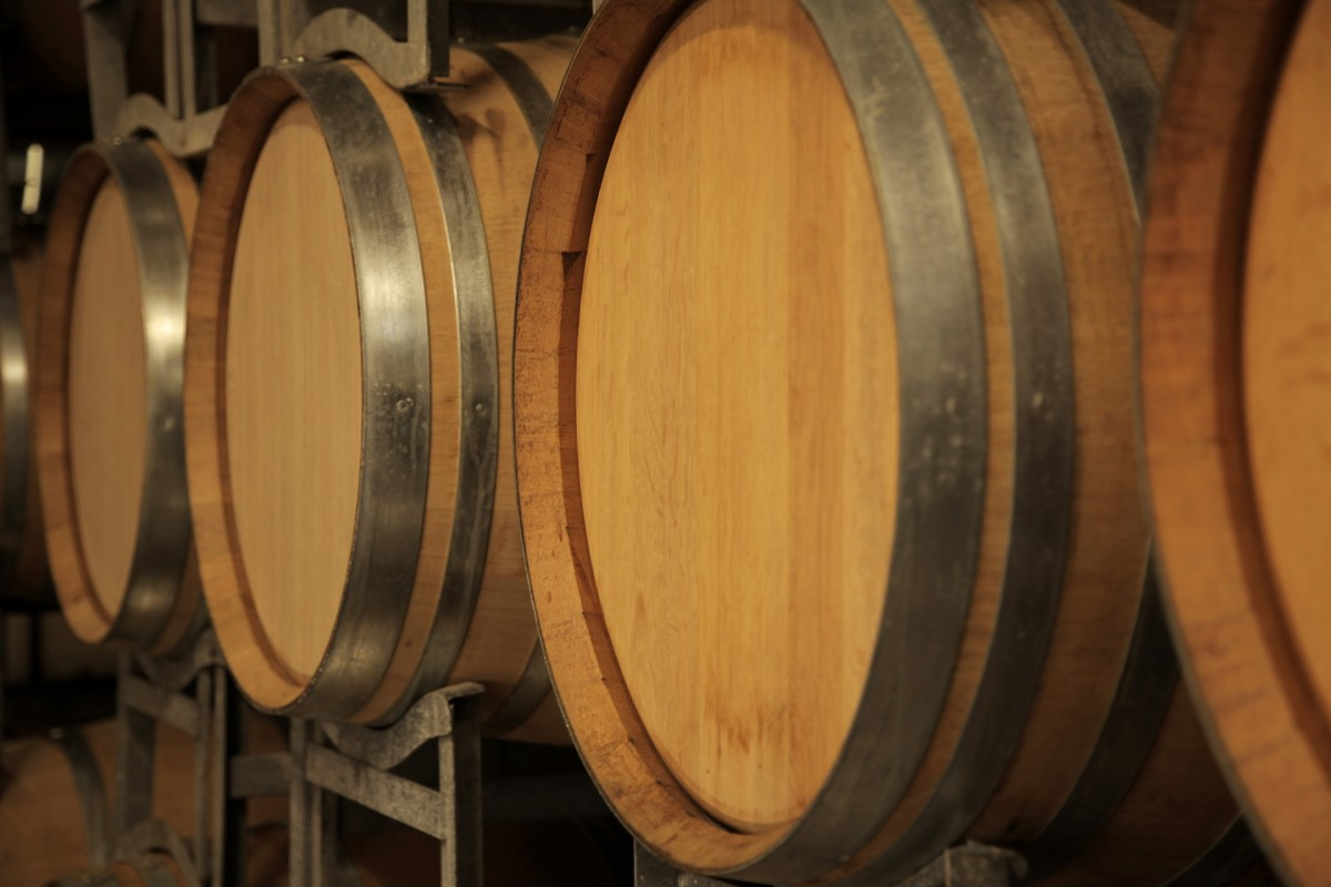 Red wine is aged in oak barrels like these.