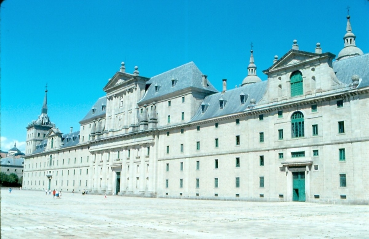The facade of the El Escorial Monastery hint at the immensity of this religious and royal complex outside of Madrid.  Built largely by Philip II of Spain, a devout Catholic, it was funded by Spain's New World gold.