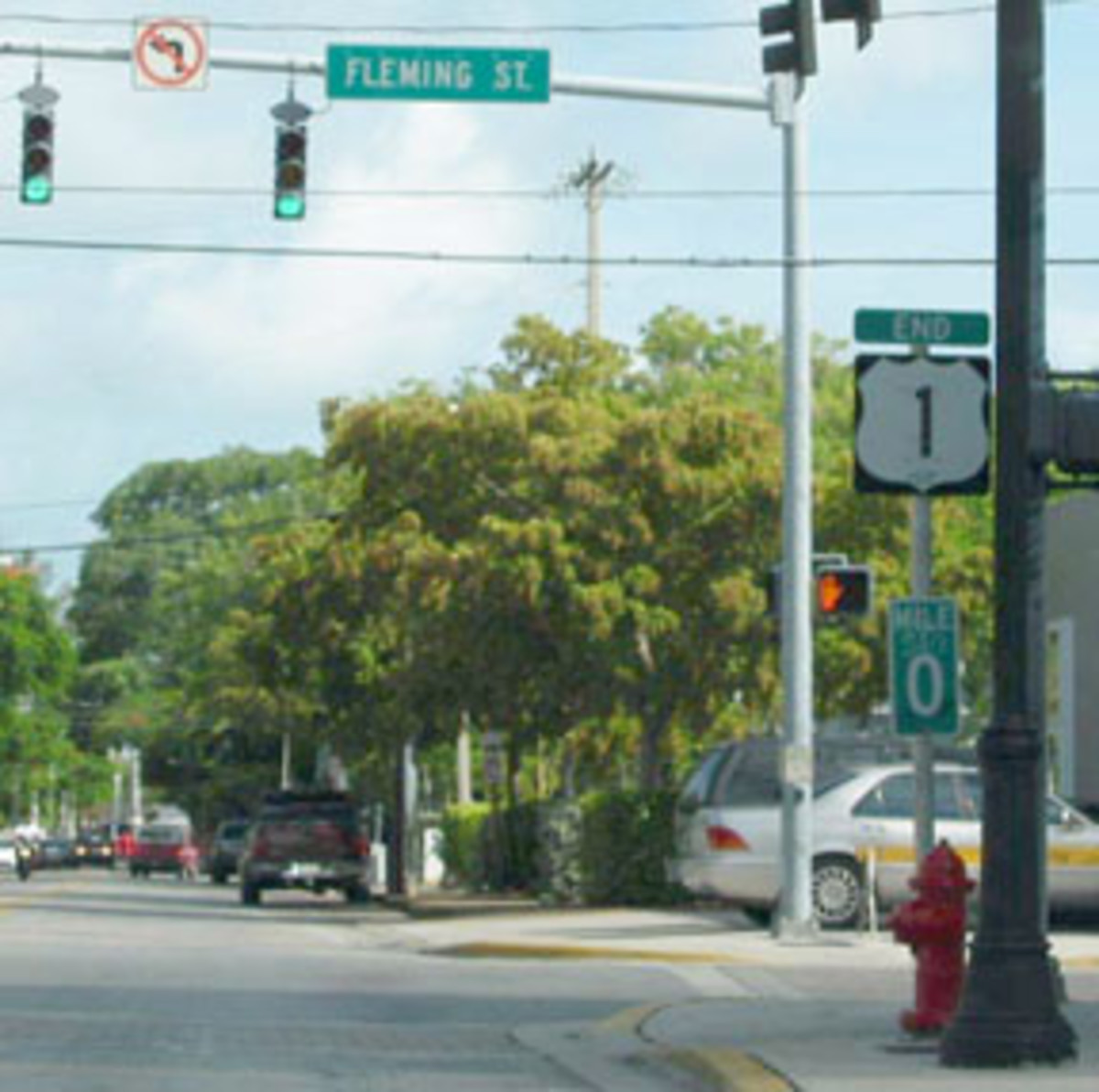 """Mile Marker """"0"""" at the intersection of Whitehead Street and Fleming Street, Key West, Florida."""