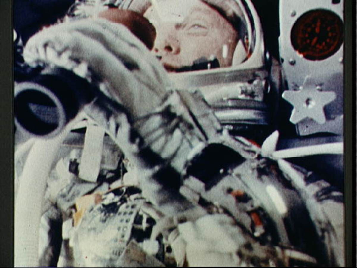 Onboard camera photographs John Glenn while in orbit. Photo courtesy of NASA.
