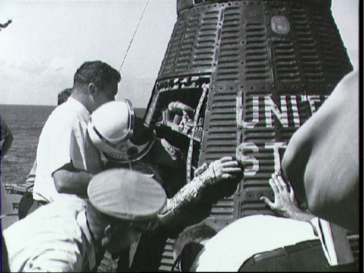 Wally Schirra exits Sigma 7 onboard the USS Kearsarge. Photo courtesy of NASA.