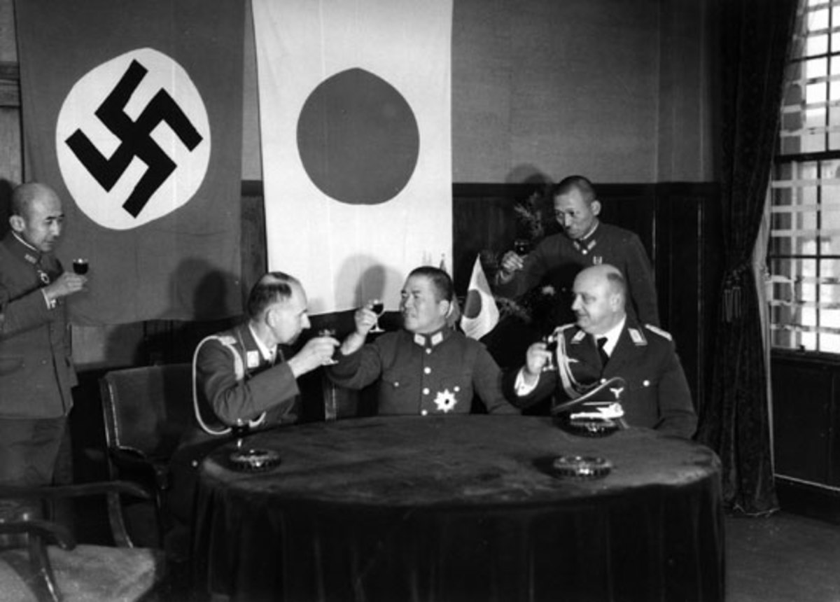 Japanese, German, and Italian leaders celebrate the signing of the Tripartite Pact.