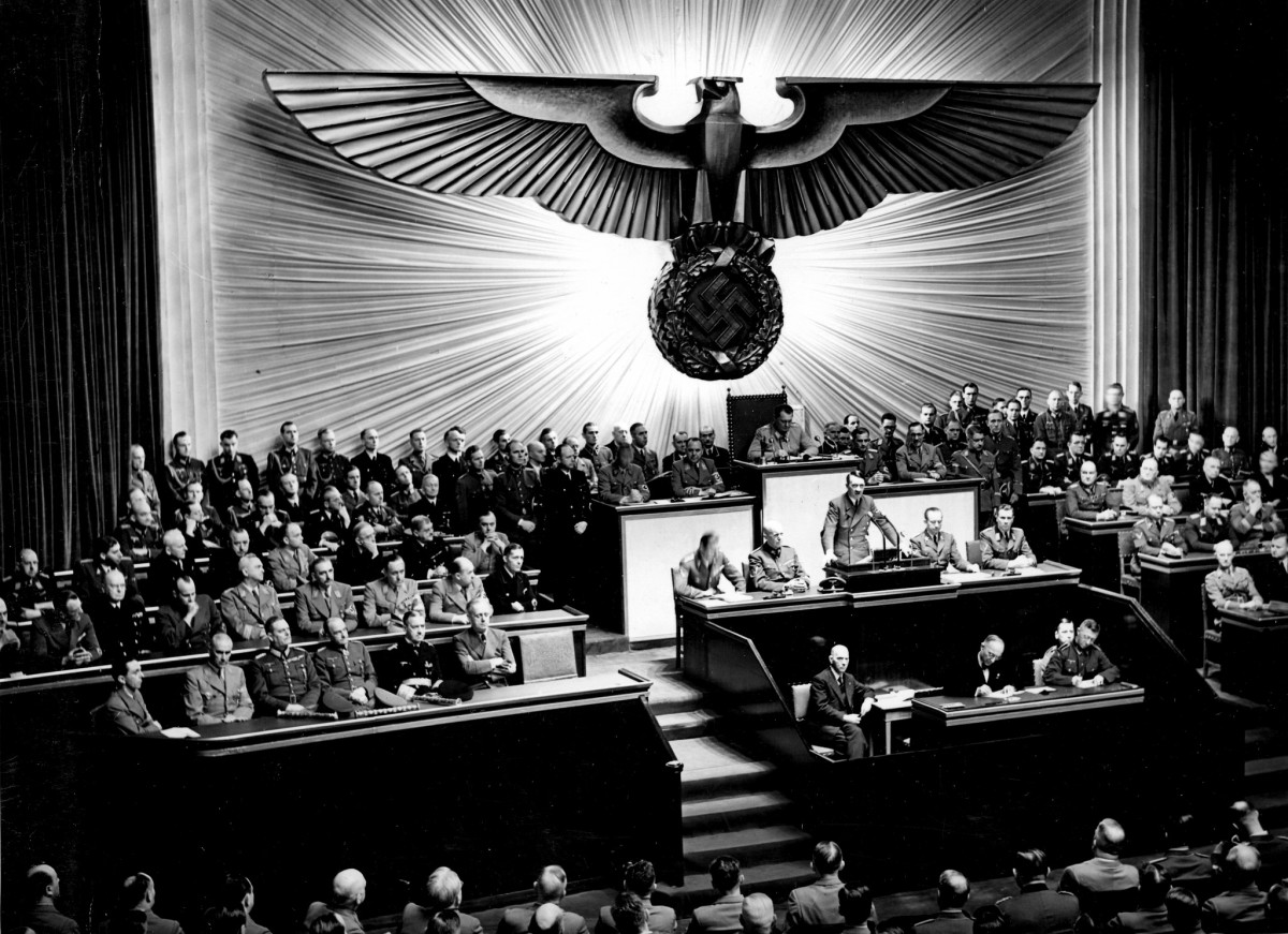 Hitler announces the declaration of war against the United States to the Reichstag.