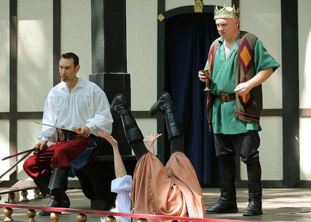 Actors acting out a scene from Hamlet.
