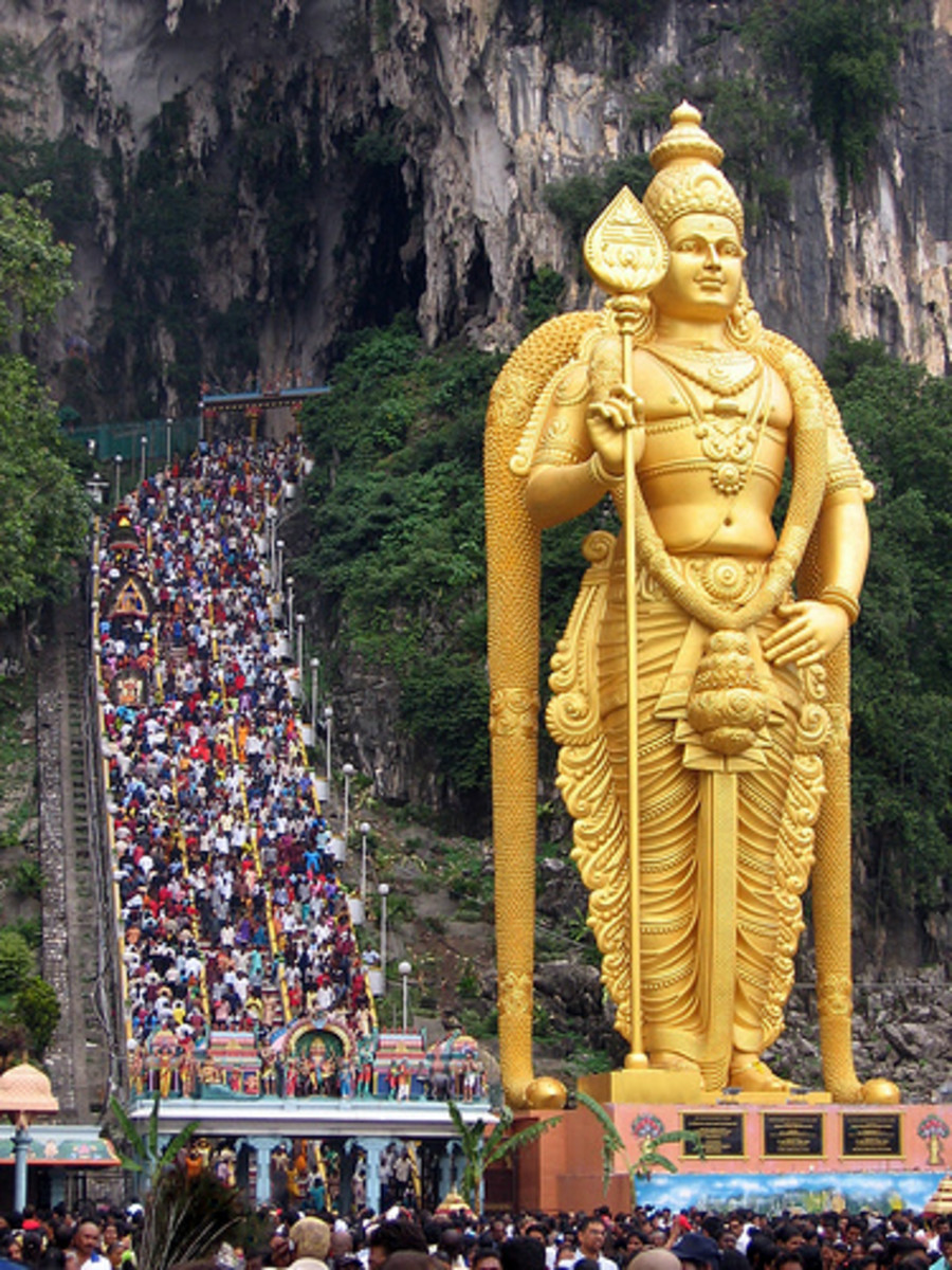 Batu Caves Temple with the famous 272 steps leading to the temple. The 140-feet statue of Lord Murugan took 3 years to complete and was unveiled during Thaipusam festival in January 2006. It was built by 15 artisans from India.