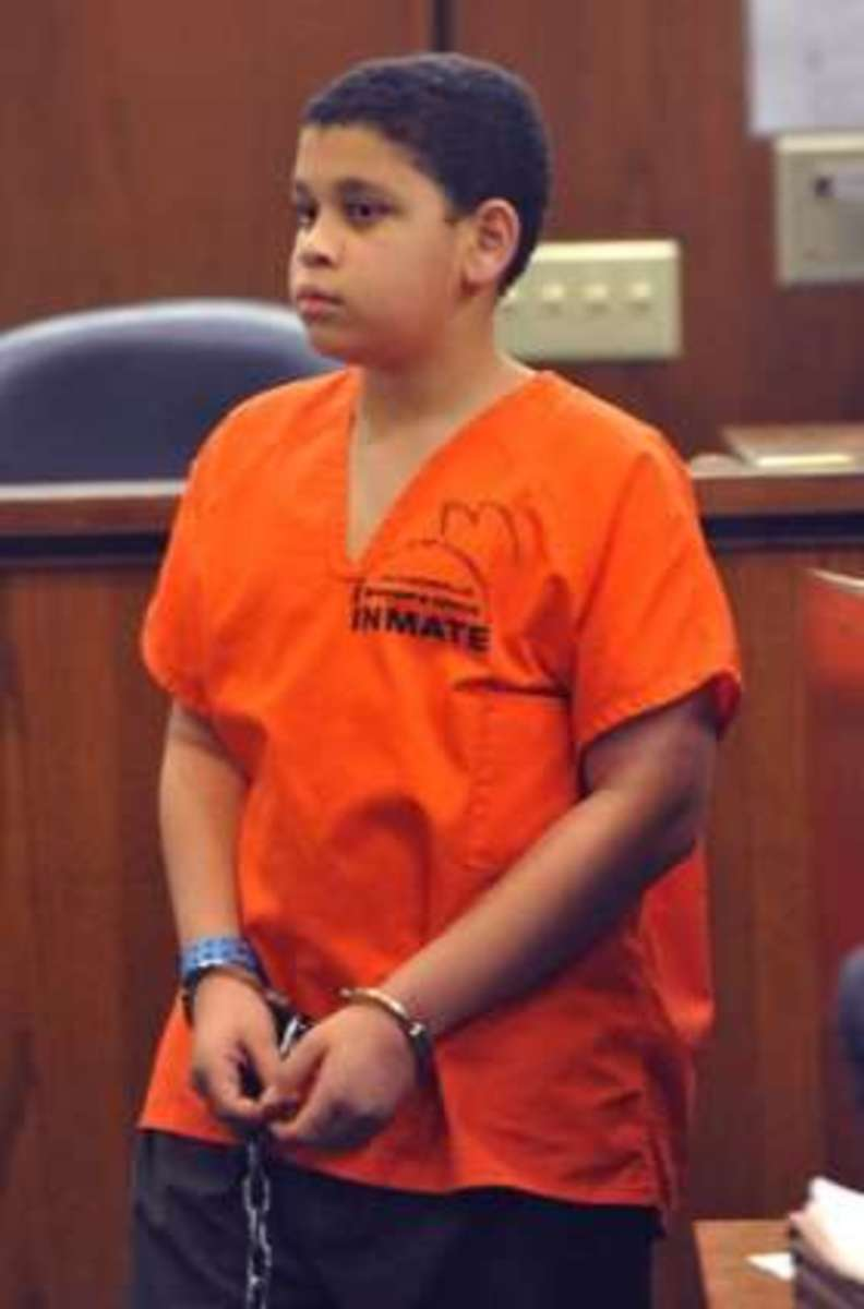 Now 13-year-old Christian at a pre-trial hearing earlier this year.  He is being charged with first-degree-murder as an adult in the death of his younger brother.