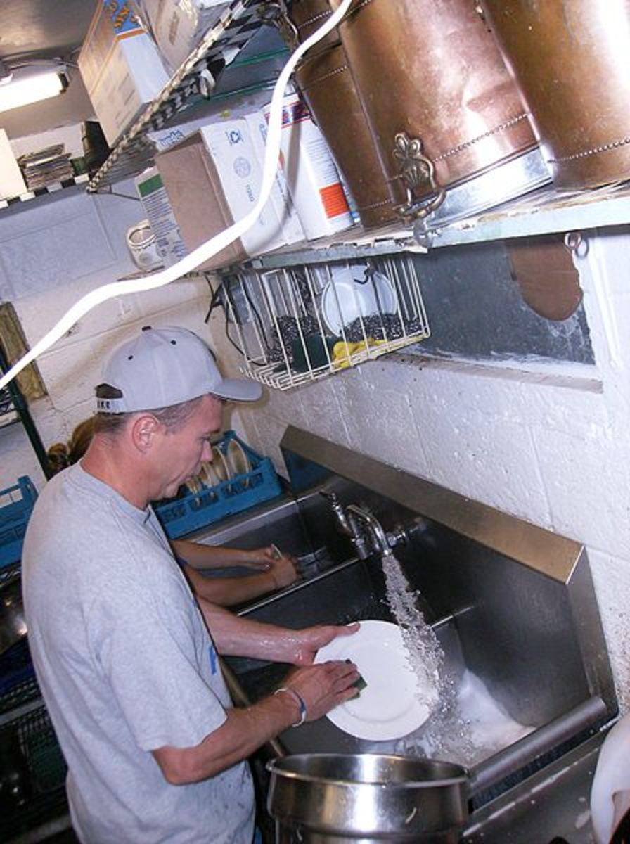 This man is washing dishes at the Our Community Place Soup Kitchen, Little Grill Collective, June 28, 2008 in Harrisonburg, Virginia.