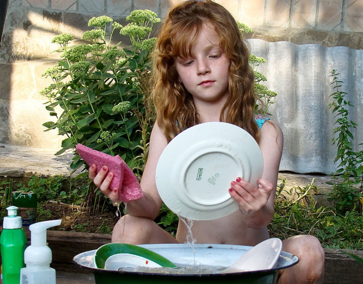 This girl is washing dishes in  Kharkov, Ukraine