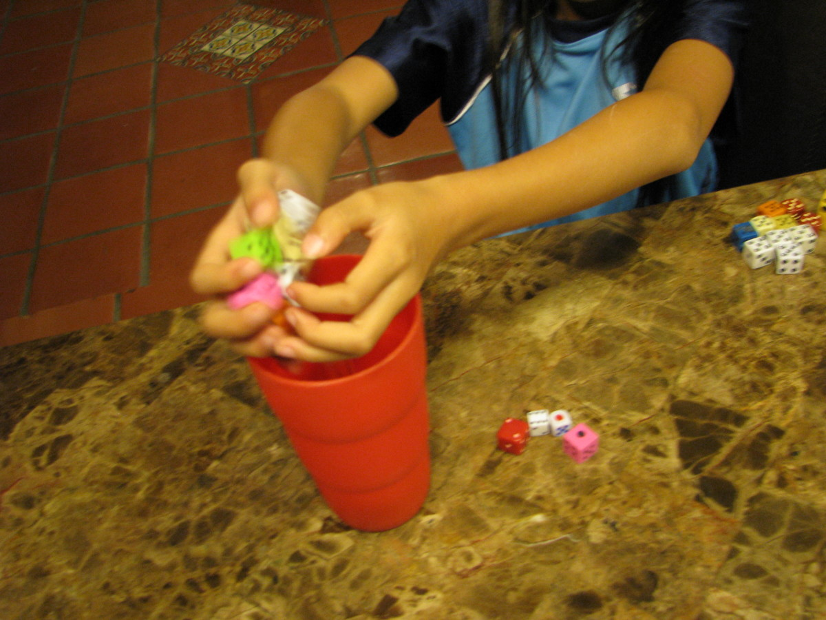 Tip: Use a cup to roll the dice to make them well mixed up.