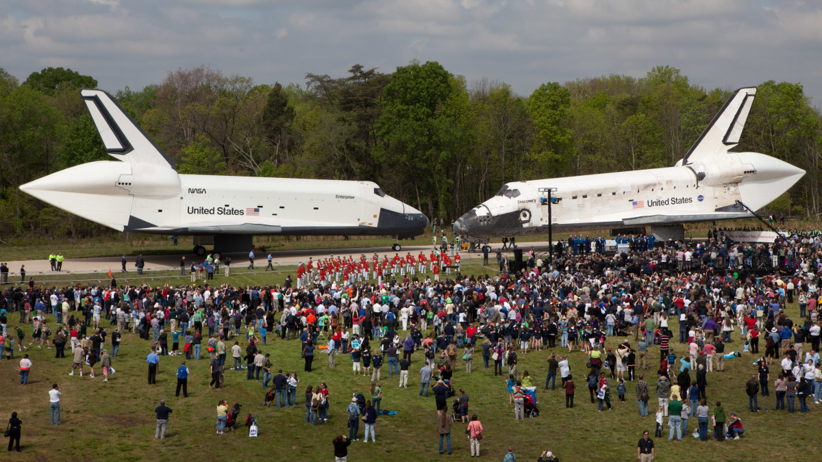 Enterprise (L) and Discovery (R) changing places at the Smithsonian's Udvar-Hazy Center.