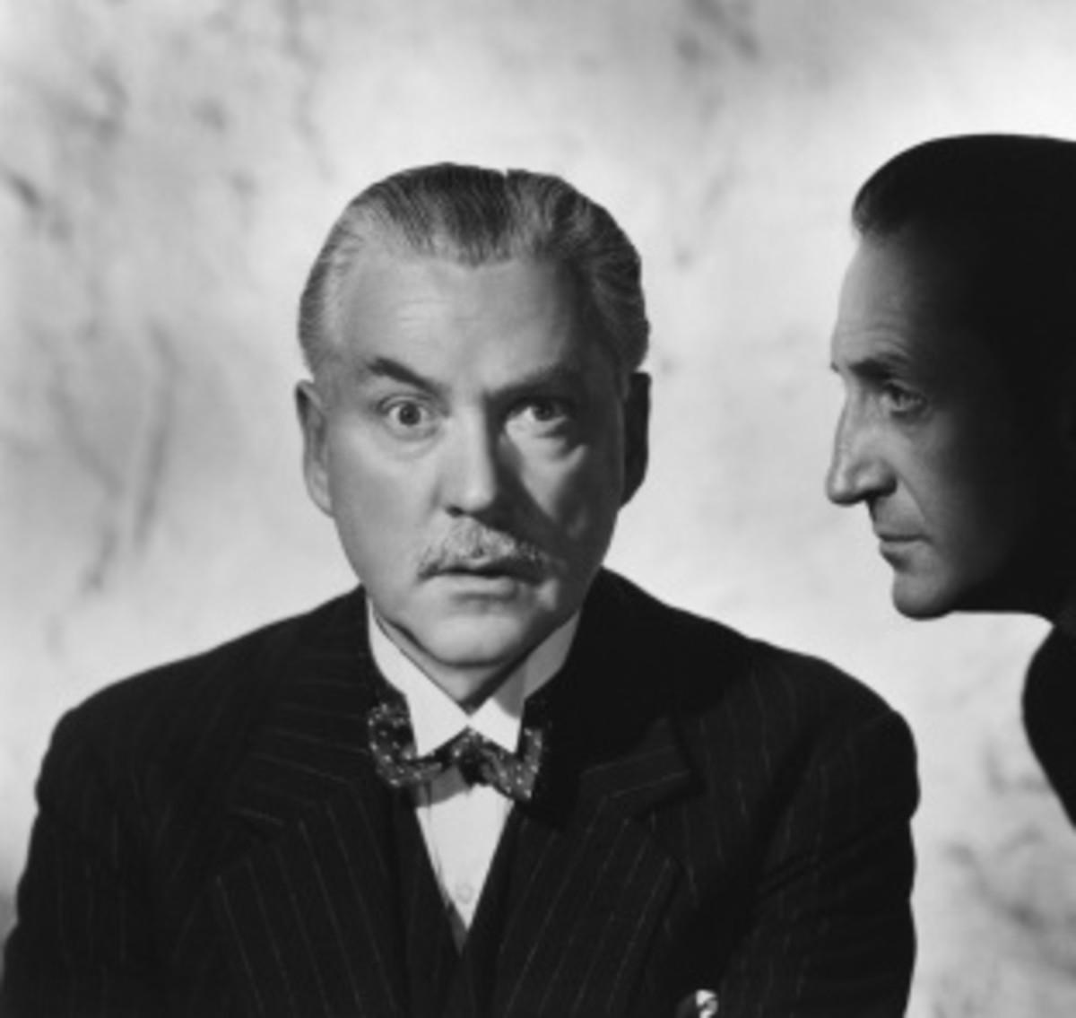 Nigel Bruce as Doctor Watson (Basil Rathbone on right)