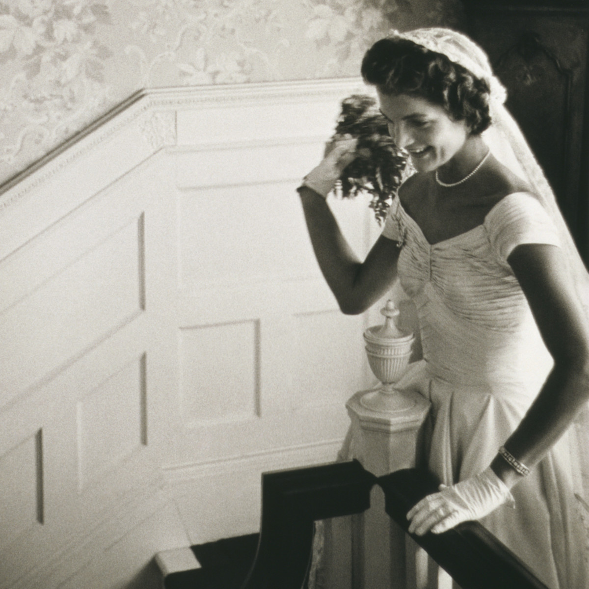 Jackie Kennedy throwing her bridal bouquet