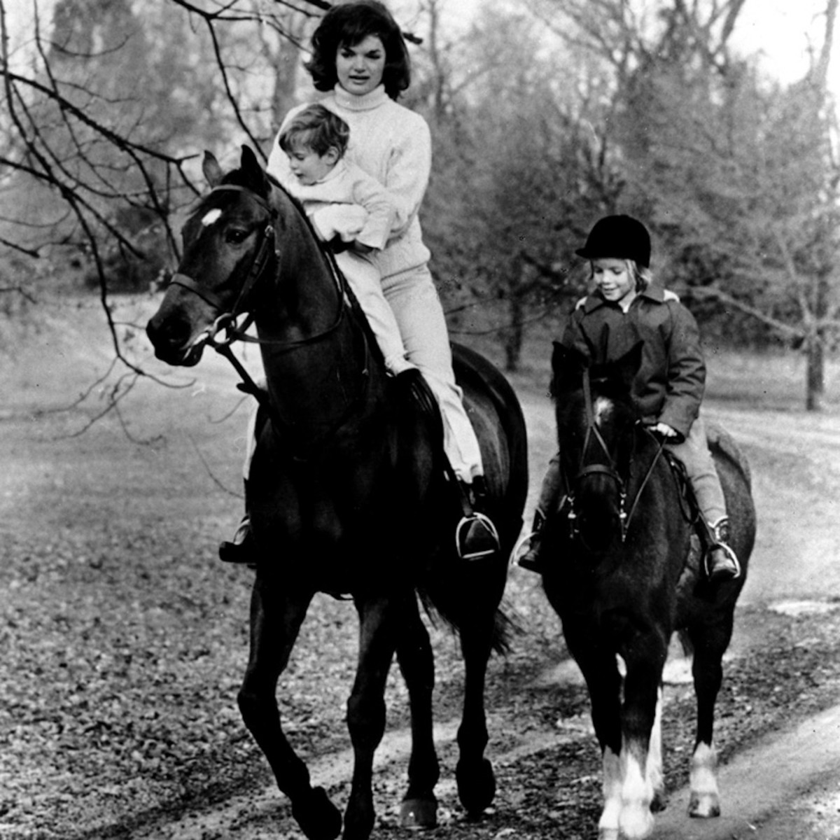 Jackie Kennedy riding with her children, Caroline and John