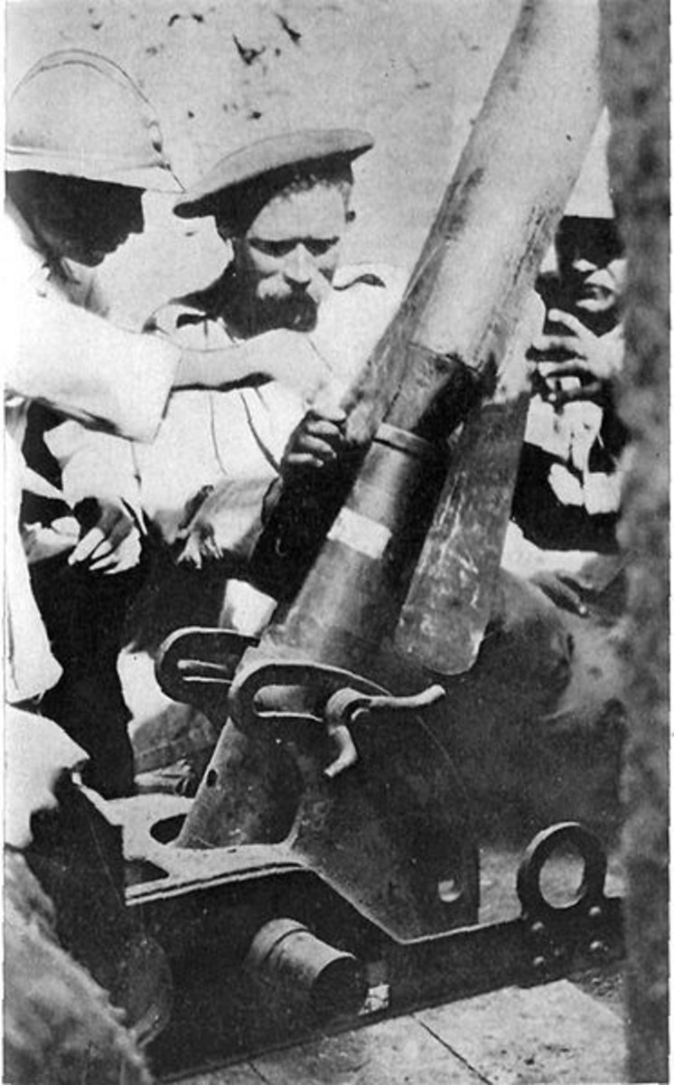 WWI: Frenchman instructiong Serbian in Use of Trench Mortar. The shell weighs about 100 pounds.