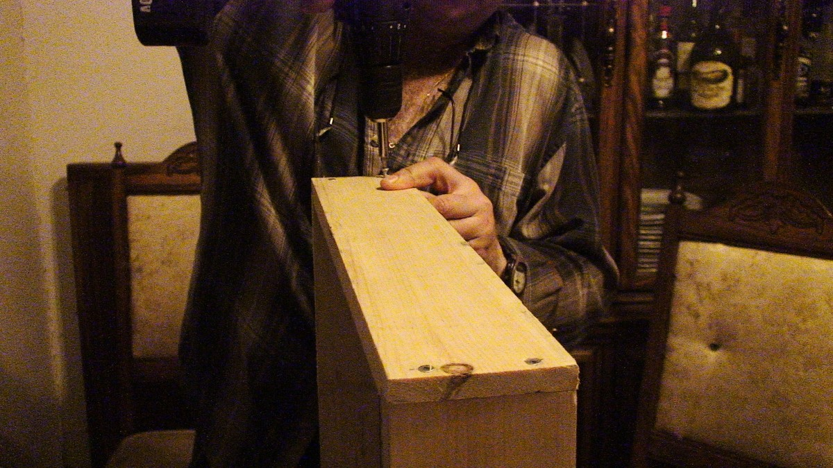 A groove was created in the centre of each wooden side to fit peg board.  The four corners of the board frame were screwed together using a drill.
