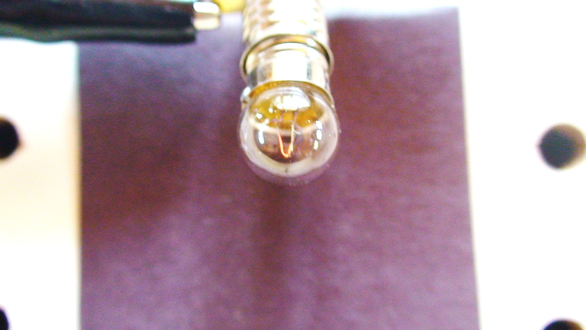 A close up of a lighted bulb.  Electrical energy has been converted to light energy by this bulb.