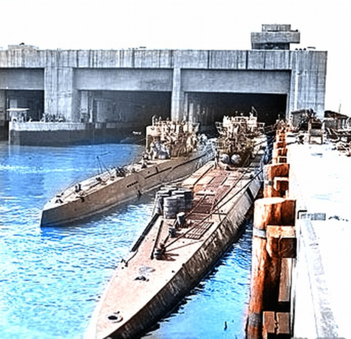 World War II: A smaller Type VII U-Boat (left) next to a large Type IX U-Boat in the submarine pens at Trondheim, Norway after the war.