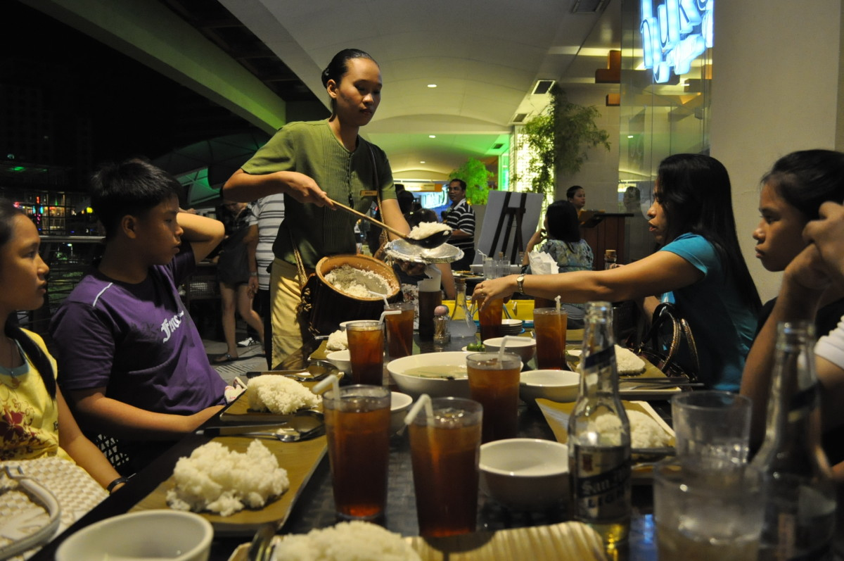Filipinos love to get together for big family meals.