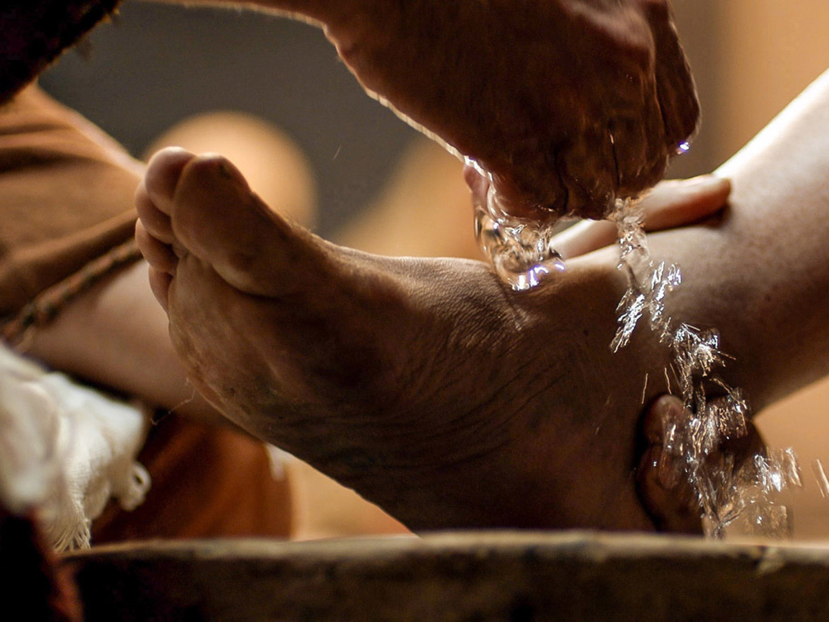 Foot washing was a common custom when guests visited. It was done by lowly servants. Here Jesus washes the disciples' feet.