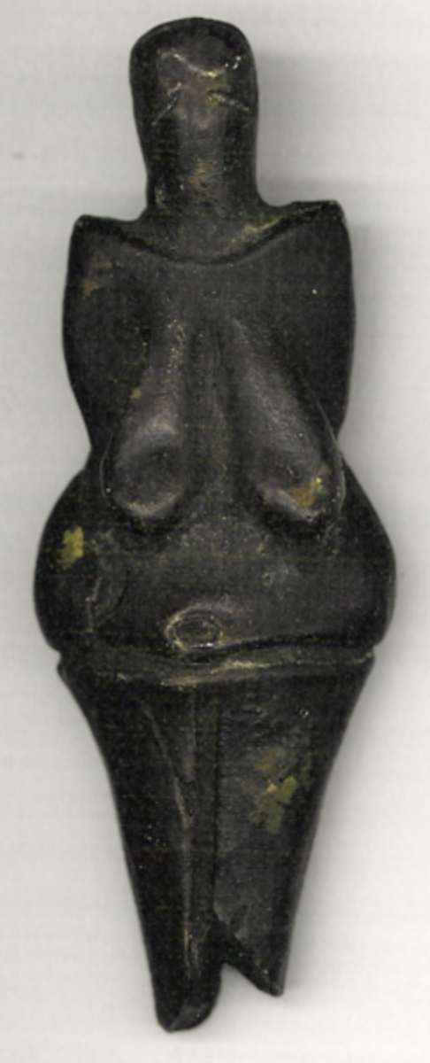 An elaborate carving known as the Venus of Dolni  Vestonice figurine- it dates from around 25,000 years ago.