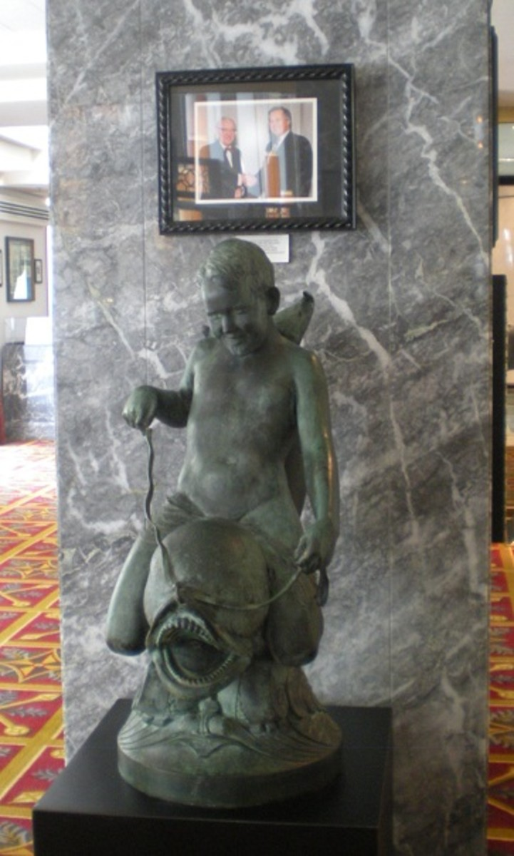Statue of winged cherub modeled by future Supreme Court Justice John Paul Stevens in Hilton Chicago museum.