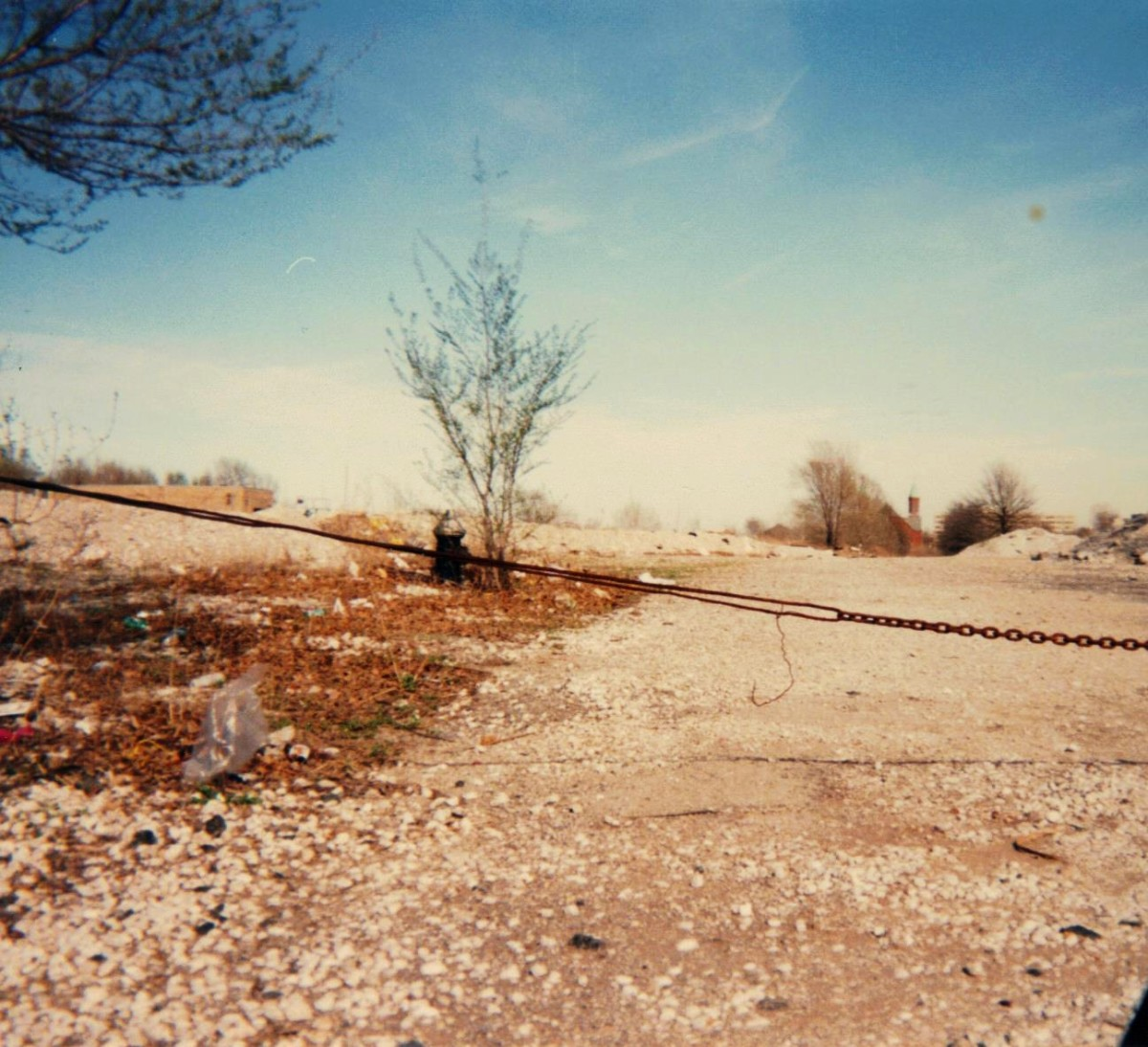 Looking east from 1301 N. Jefferson Avenue, April , 1996.  A fire hydrant still stands next to the rubble of what used to be the major street headed into the project.
