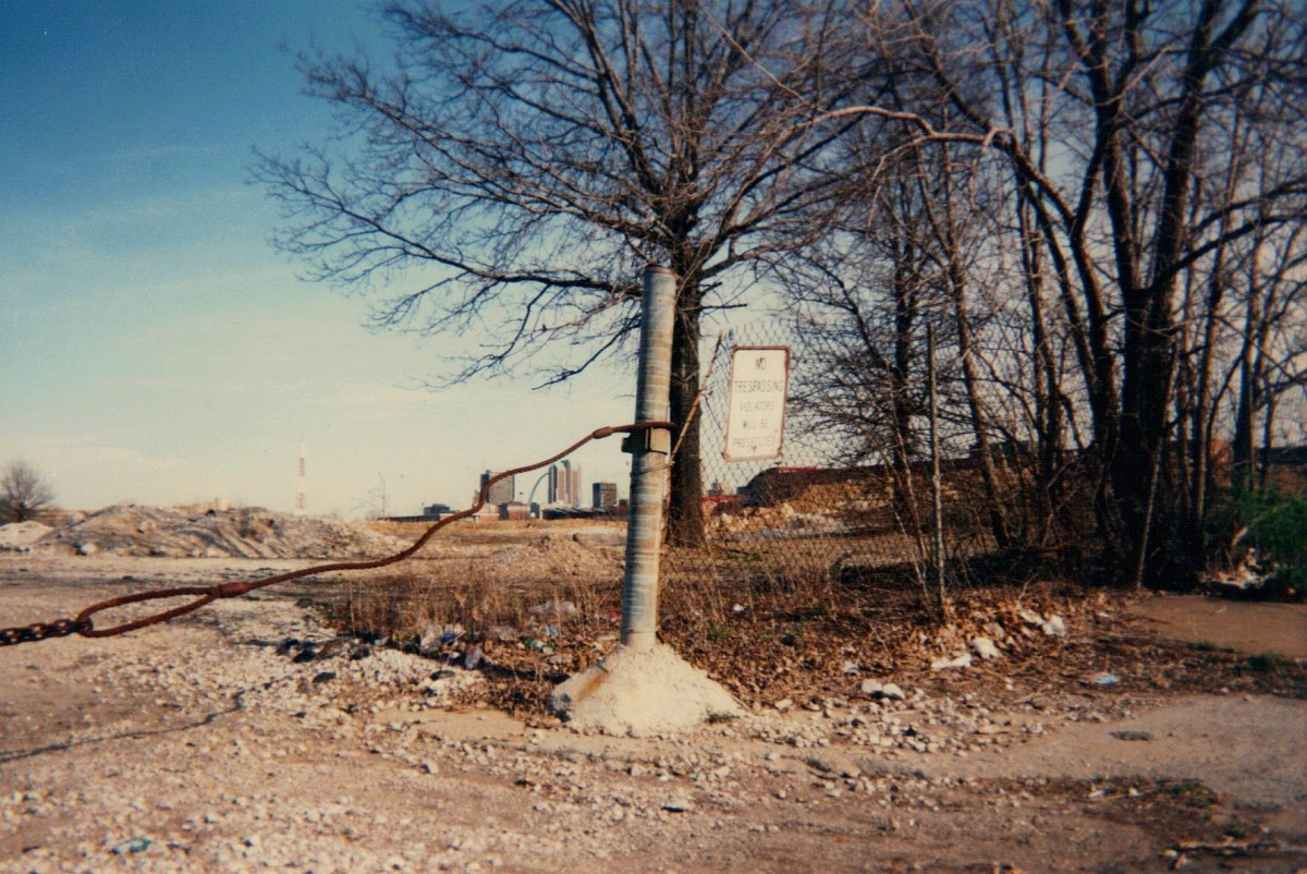 Looking east from 1301 N. Jefferson Avenue, April , 1996.  The site is still vacant today, although more overgrown with brush and small trees.