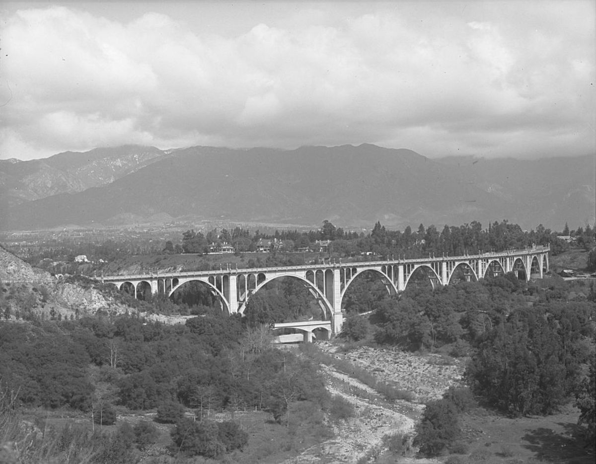 The Colorado Street Bridge, pictured here, is featured in Mildred Pierce. This is the route Mildred takes to Monty's family home in Pasadena.