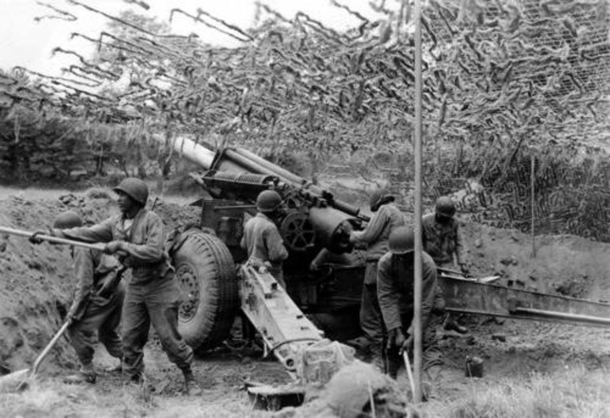 155mm battery, Normandy 1944. One of the most subtle but important changes between the wars was the use of pneumatic tires.