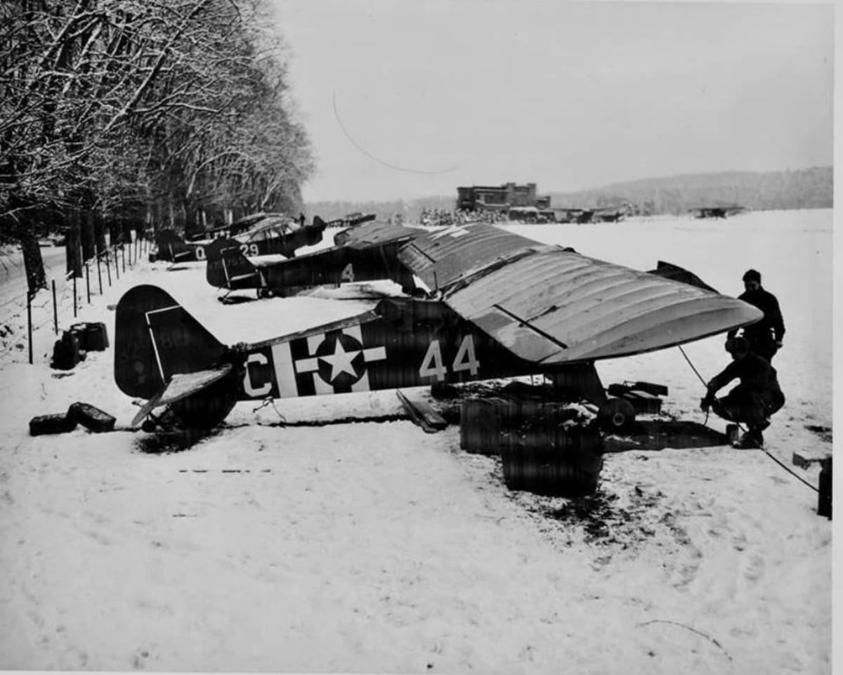 Flight line of L-4s during the winter of 1945
