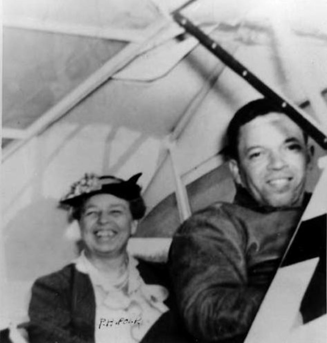 "Mrs. Roosevelt and C. Alfred ""Chief"" Anderson in the plane"