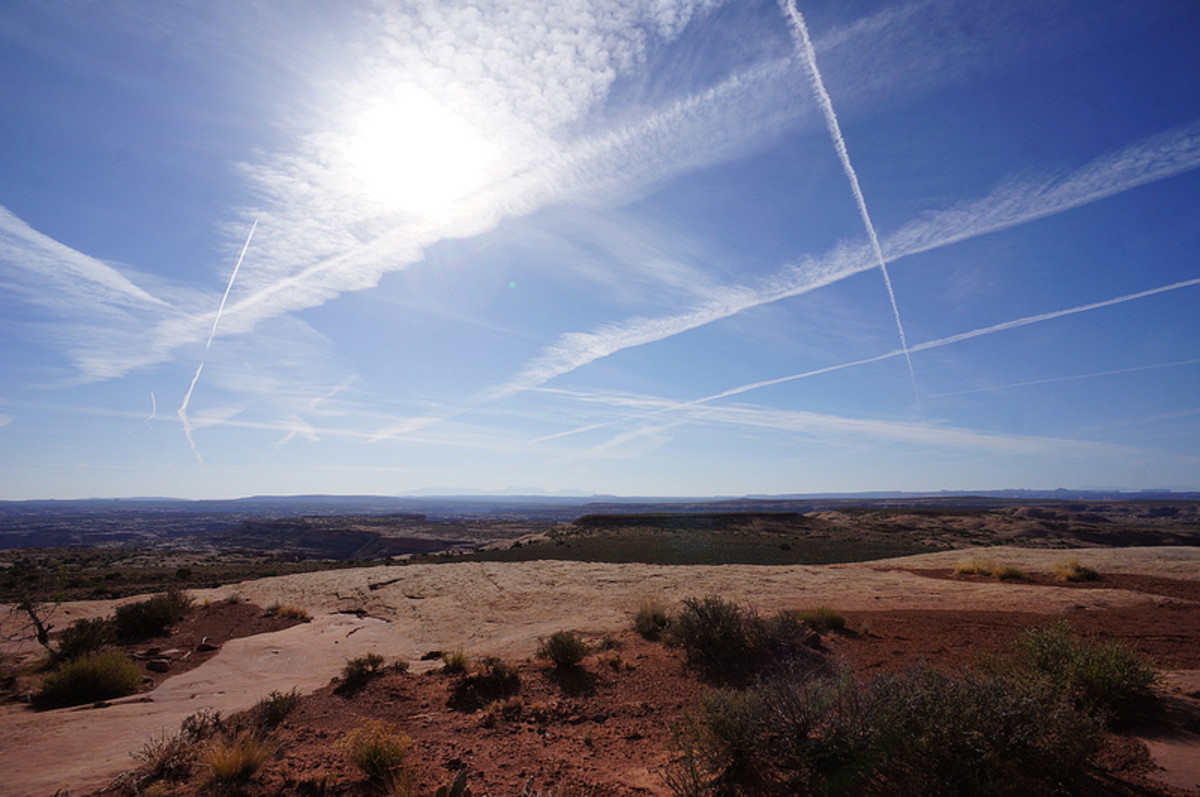 Persistent contrails like these are produced under cold and humid conditions in the upper atmosphere.