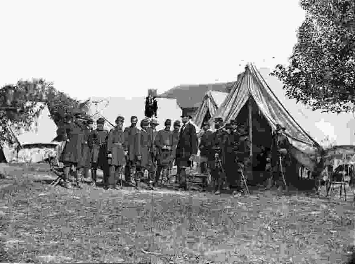 Custer (far right) was at McClellan's HQ when Lincoln visited two weeks after the Battle of Antietam.