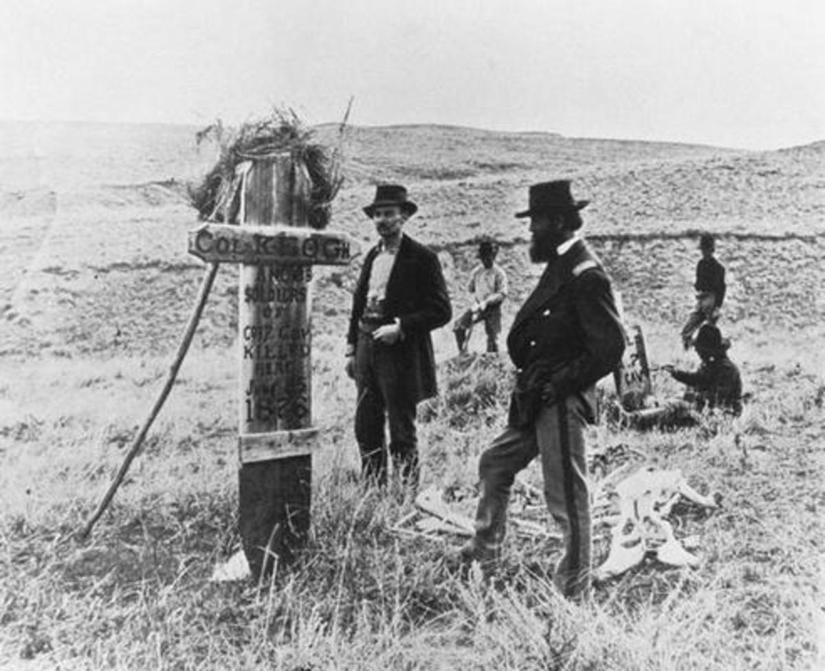 Soldiers standing by a marker showing where Keough's body was found.  Original photo was taken by famed Western photographer Laton Alton Hoffman.