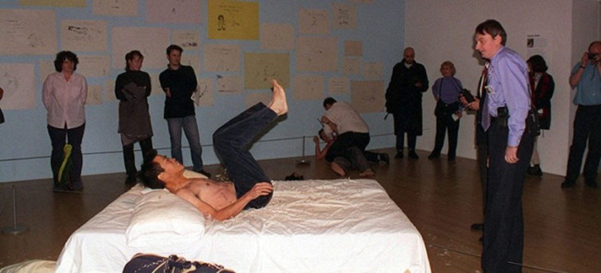 "Yuan Cai and Jian Jun Xi stripped down to their pants and jumped on Tracy Emin's ""My Bed"" at the Tate London Gallery in 1999"