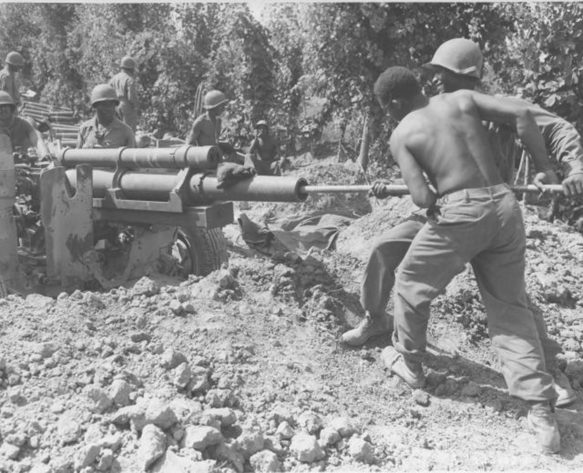 598th gun crew cleaning their 105mm.
