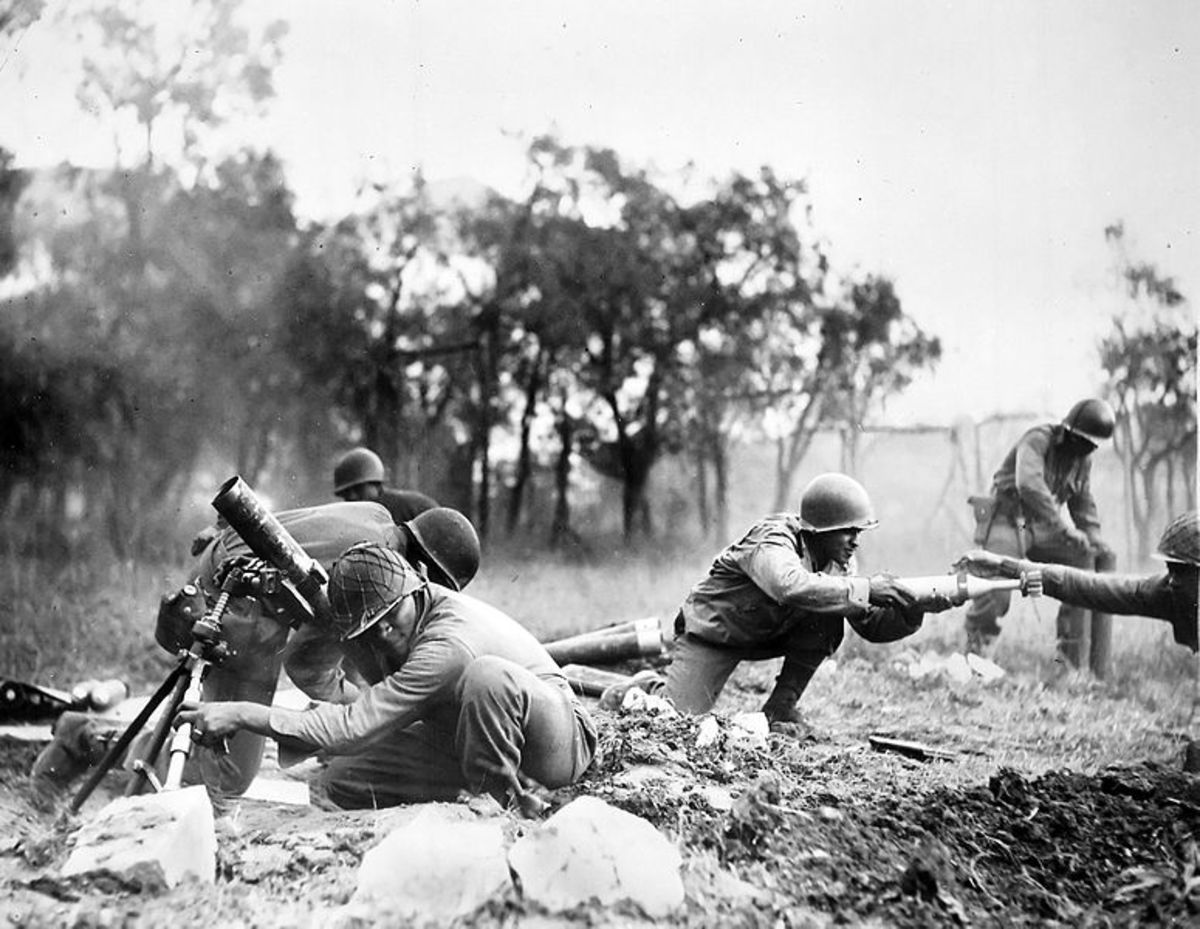 92nd ID troops fighting near Massa, Italy, Nov-1944.