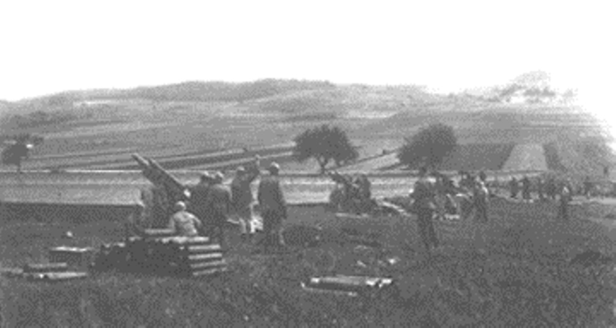 Battery of the 861st FA prepares to fire.