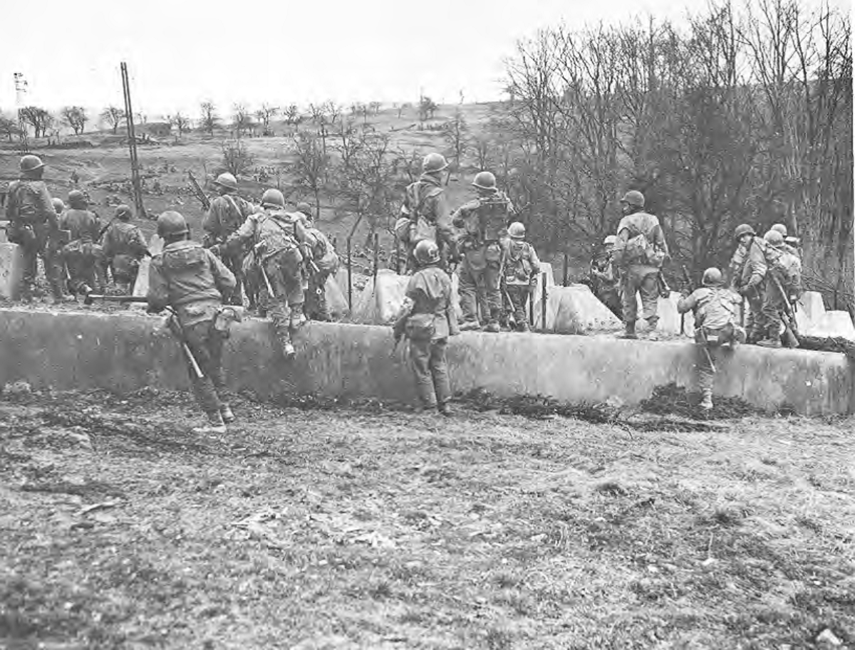 A squad from the 63rd ID going through the West Wall.